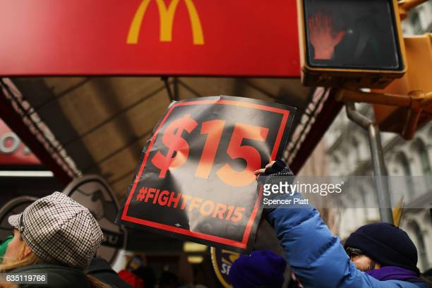 Protesters with NYC Fight for $15 gather in front of a McDonalds to rally against fast food executive Andrew Puzder who is President Donald Trump's...