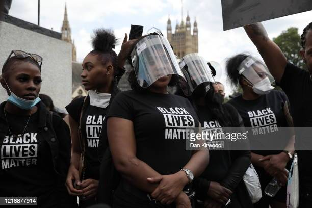 Protesters with personal protective equipment are gathering in Parliament Square to commemorate the life of George Floyd at 5pm the time when his...