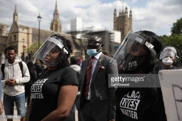 Protesters with personal protective equipment are gathering in Parliament Square to commemorate the life of George Floyd at 5pm, the time when his...
