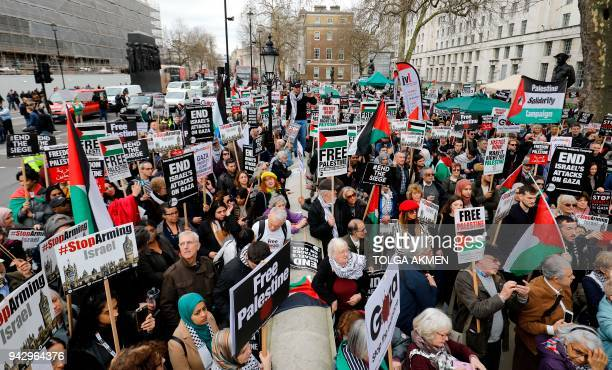 Protesters with placards and Palestinian flags crowd the street during a demonstration on Whitehall opposite Downing Street in central London on...