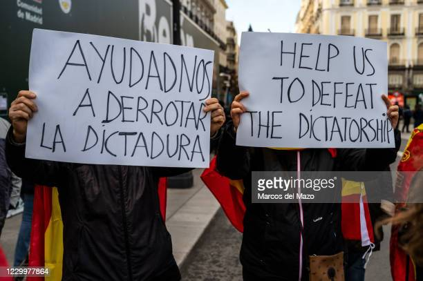 Protesters with placards during a demonstration marching to the Congress of Deputies to protest against the Government and demanding the resignation...