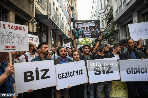 Protesters with placards reading We are gezi protesters they are about to go on May 31 2018 in Istanbul to mark the fifth anniversary of the start of...