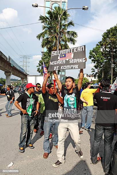 Protesters with political placard banner at the protest rally against election fraud on June 22, 2013 in Padang Merbuk, Kuala Lumpur, Malaysia.