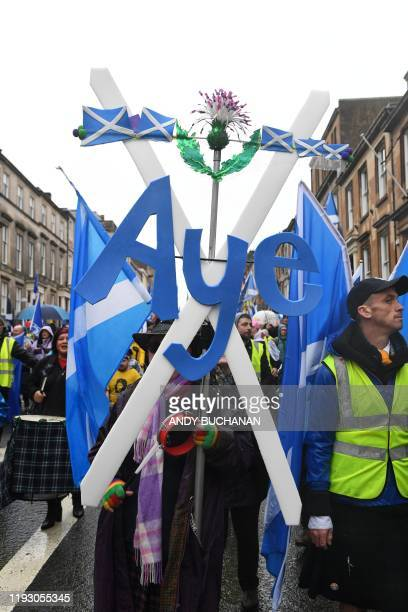 Protesters with Scottish Saltire flags attend a march organised by the grassroots organistaion All Under One Banner calling for Scottish independence...