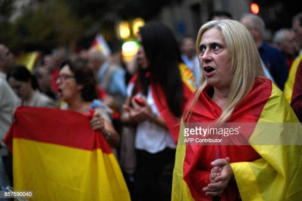 Protesters with Spanish flags shout slogans in favour of Spanish Constitution during a demonstration defending a united Spain on October 4 2017 in...