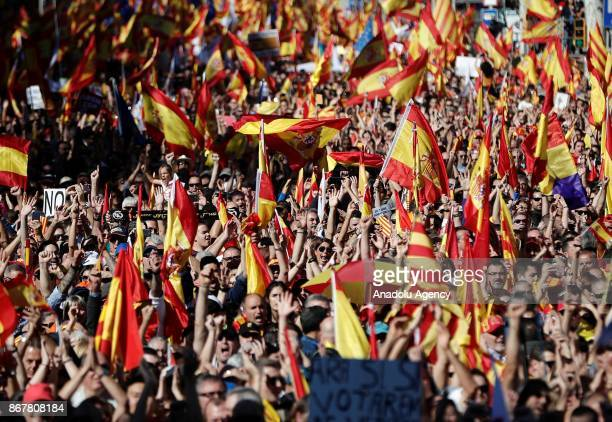Protesters with Spanish flags stage a prounity demonstration at Passeig de Gracia in Barcelona Spain on October 29 2017 Thousands of prounity...