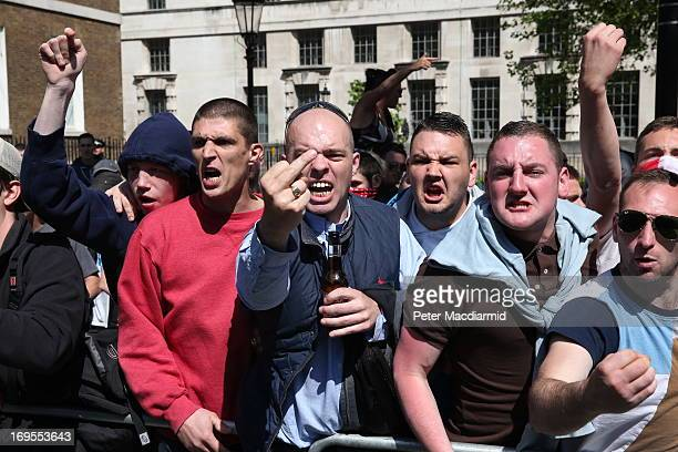 Protesters with the English Defence League gesture towards a counter demonstration held by the group Unite Against Facism in Whitehall outside...