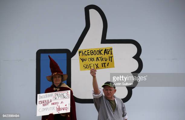 """Protesters with the group """"Raging Grannies"""" hold signs during a demonstration outside of Facebook headquarters on April 5, 2018 in Menlo Park,..."""