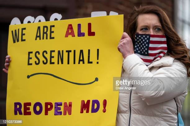 Protesters with the group Reopen Maryland rally near the State House to call on the state to lift the stayathome order and reopen the economy on...