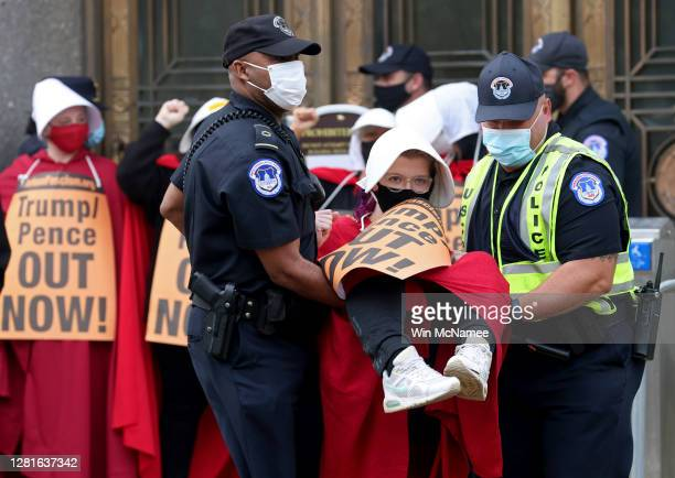 "Protesters with the ""Handmaids Brigade"" are arrested outside the Dirksen Senate Office Building while a hearing held by the Senate Judiciary..."