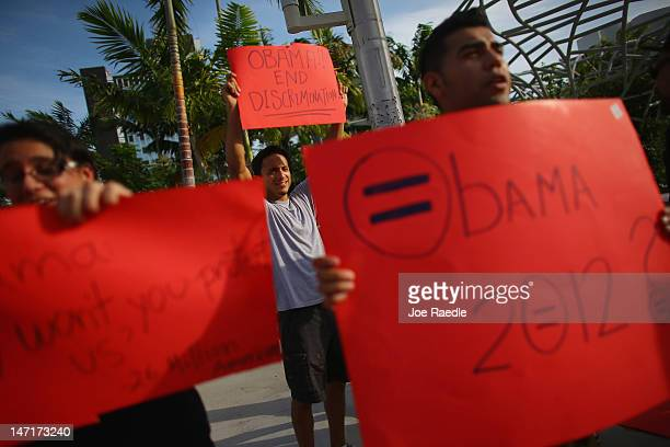 Protesters with the lesbian gay bisexual and transgender Americans and their supporters make their views known as they stand outside a President...
