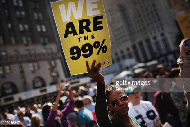 """Protesters with the """"Occupy Wall Street"""" movement demonstrate before walking up 5th Avenue to rally in front of the residence of NewsCorp CEO Rupert..."""