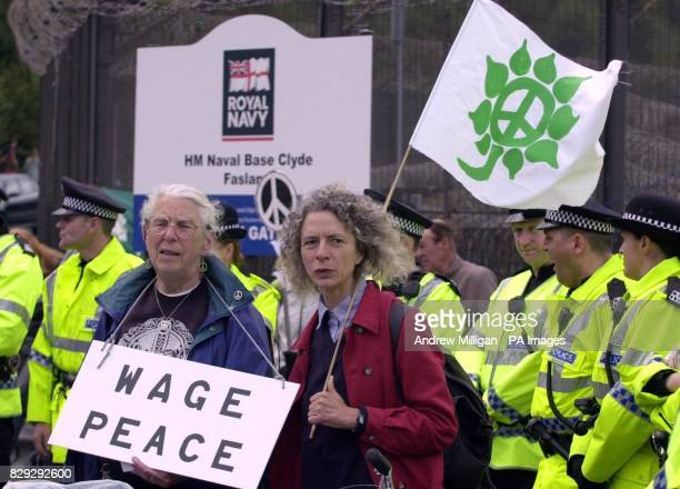 Protesters with their placards during an antinuclear campaign attempt to blockade the Faslane nuclear submarine base on the Clyde Scotland The...