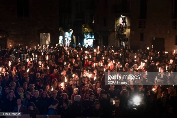 Protesters with torches take part during the demonstration. Hundreds of supporters for the independence of Catalonia marched carrying torches lit to...