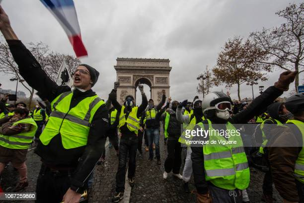 Protesters yell during a 'Yellow Vest' demonstration near the Arc de Triomphe on December 1 2018 in Paris France The third 'Yellow Vest' rally in...
