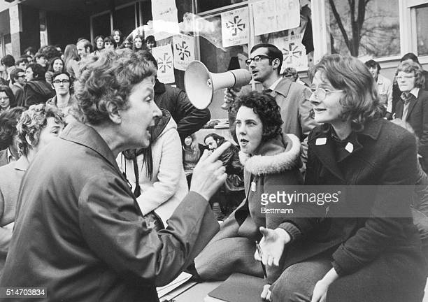 Protesting against discrimination in jobs and housing, Roman Catholic demonstrators in Belfast talk with an angry Protestant woman from the Sandy Row...