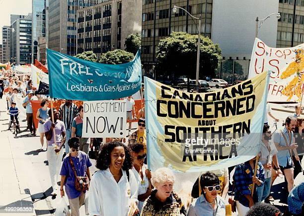 Protesting apartheid About 700 protesters members of the Toronto AntiIntervention Coalition marched from city hall yesterday to protest Canadian and...