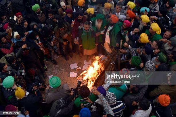 Protesting farmers to burn copies of new agriculture laws on Lohri festival at Singhu Border on January 13, 2021 in New Delhi, India.
