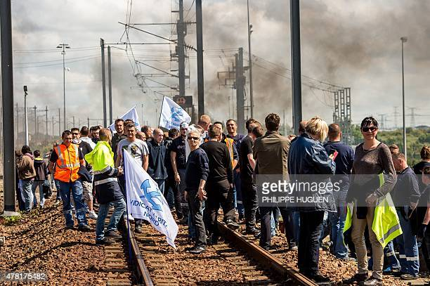 Protesting French employees of the company English Channel passenger and freight ferry company 'MyFerryLink' block the railway tracks of the Eurostar...