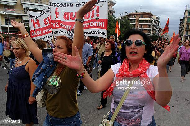 Protesting Greek teachers clap and cheer in protest over austerity cuts in the northern port city of Thessaloniki, Greece.