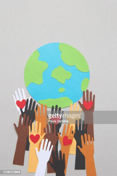 protesting hands around a globe - equality stock pictures, royalty-free photos & images