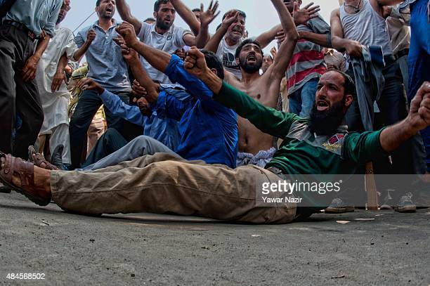 Protesting Kashmiri government Public Health Engineering employees shout anti government slogans during a protest against the government on August 20...