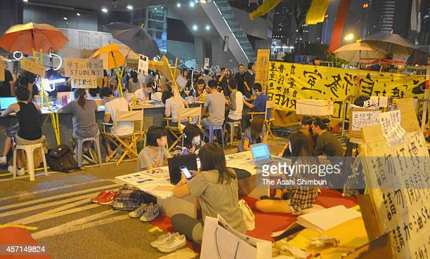 Protesting students do their homework in the Admiralty district on October 11, 2014 in Hong Kong. Pro democracy supporters continue to occupy the...