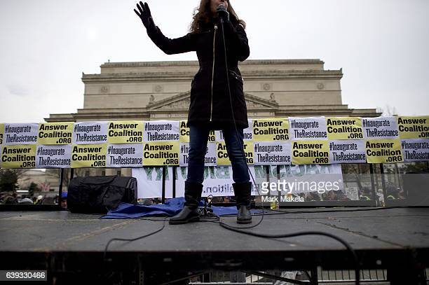 A protestor addresses a group demonstrating near the National Mall before the inauguration of Donald Trump as the 45th President of the United States...