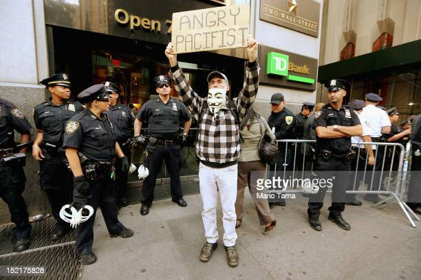 A protestor affiliated with Occupy Wall Street stands near Wall Street on September 17 2012 in New York City Today is the one year anniversary of...