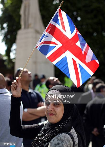 A protestor against drone attacks in Pakistan waves a Union flag as US President Barack Obama and British Prime Minister David Cameron arrive at the...