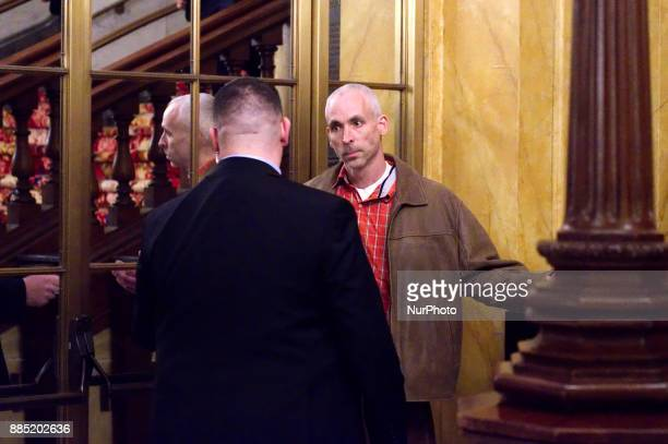 Protestor and conspiracy theorist Howard Caplan of NorthEast Philadelphia is removed by security after shouting from the balcony at Hillary Clinton...