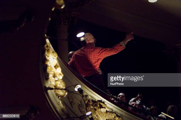 Protestor and conspiracy theorist Howard Caplan of NorthEast Philadelphia shouts at Hillary Clinton from the balcony during a book tour stop at the...