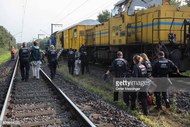 Protestor are detained by German police officers after she and others blocked a rail track that serves as a main route for trains carrying coal to...
