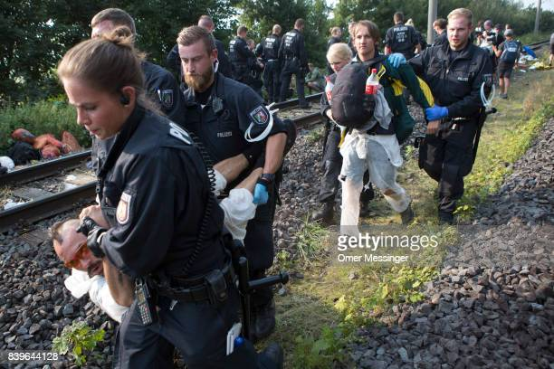 Protestor are detained by German police officers after they and others blocked a rail track that serves as a main route for trains carrying coal to...