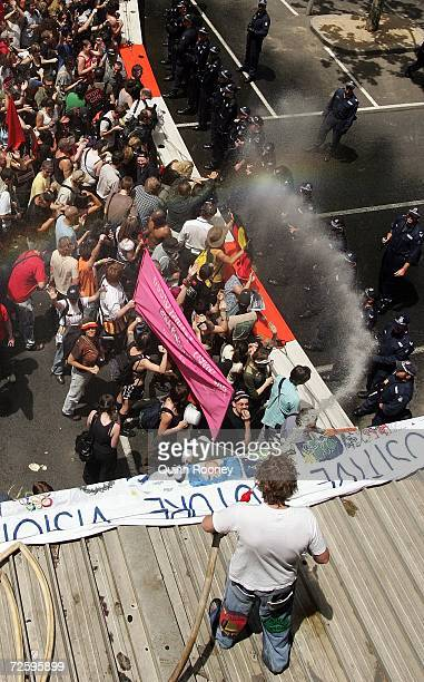 A protestor armed with a fire hydrant sprays the police as protestors rallying against the G20 meeting attempt to cross Police barricades in Russell...