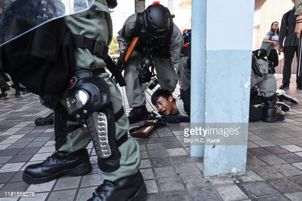 A protestor arrested by riot police in Wong Tai Sin district on November 11 2019 in Hong Kong China Antigovernment protesters organized a general...
