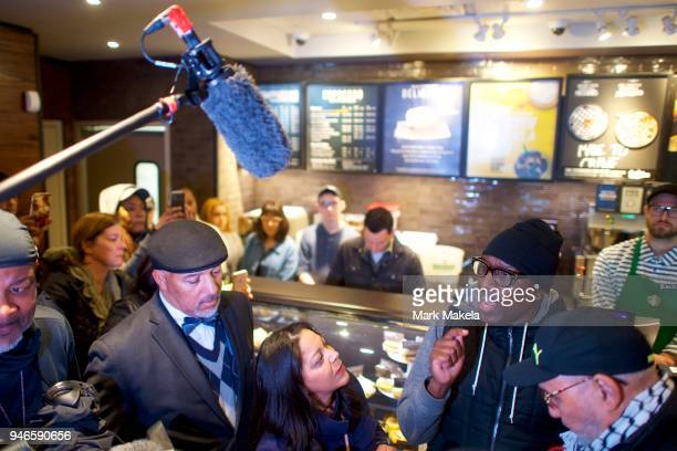 Protestor Asa Khalif addresses Starbucks MidAtlantic Regional Vice President Camille Hymes in a Center City Starbucks on April 15 2018 in...