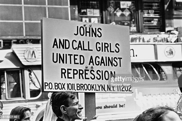 A protestor at a People's Convention in New York City just before the Democratic National Convention 10th August 1980 His sign reads 'Johns and Call...