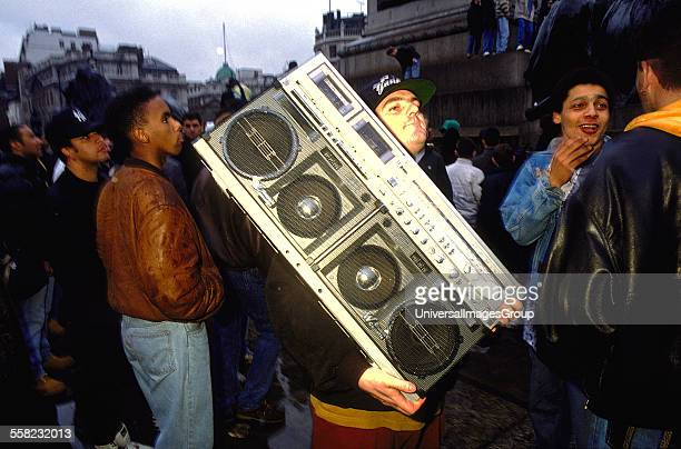 Protestor at 'Freedom to Party' demonstration carrying a just about portable tape deck Trafalgar Square London 1990