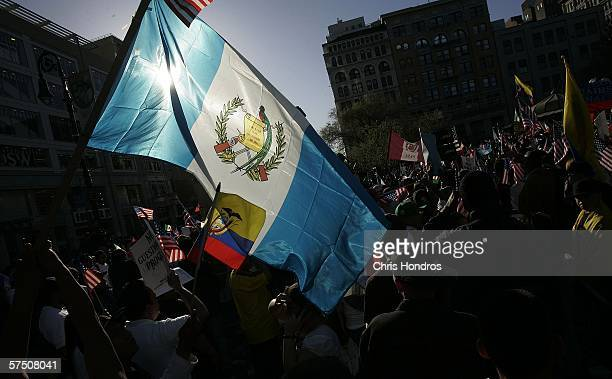 A protestor brandishes the flag from Guatemala during a proimmigration rally in Union Square May 1 2006 in New York City Activists and immigrants...