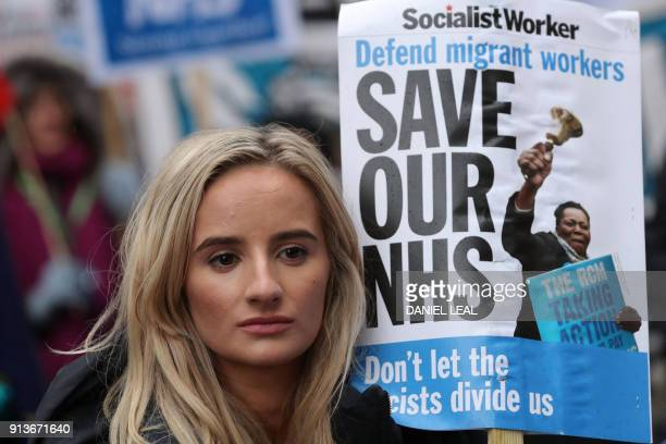 A protestor carries a placard during a march calling for an end to the 'crisis' in the staterun National Health Service in central London on February...
