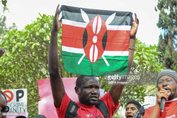 A protestor carry a Kenyan Flag as citizens protest in the streets of the capital city Nairobi Protesters took to the streets to call on the...