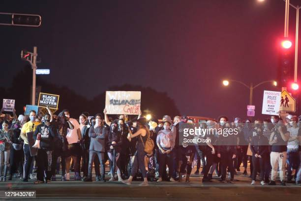 Protestor confront police and National Guard troops near the Wauwatosa City Hal on October 09, 2020 in Wauwatosa, Wisconsin. The city has faced three...