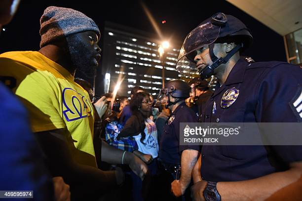 A protestor confronts a police officer November 25 2014 in Los Angeles California during demonstrations one day after a grand jury decision not to...