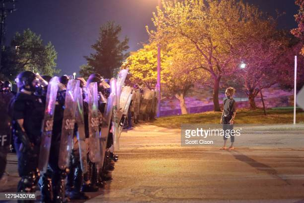 Protestor confronts police and National Guard troops near the Wauwatosa City Hal on October 09, 2020 in Wauwatosa, Wisconsin. The city has faced...
