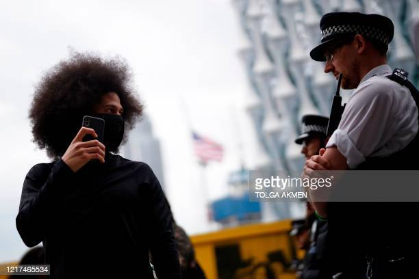 Protestor confronts police officers outside the US Embassy during an anti-racism demonstration in London on June 3 after George Floyd, an unarmed...