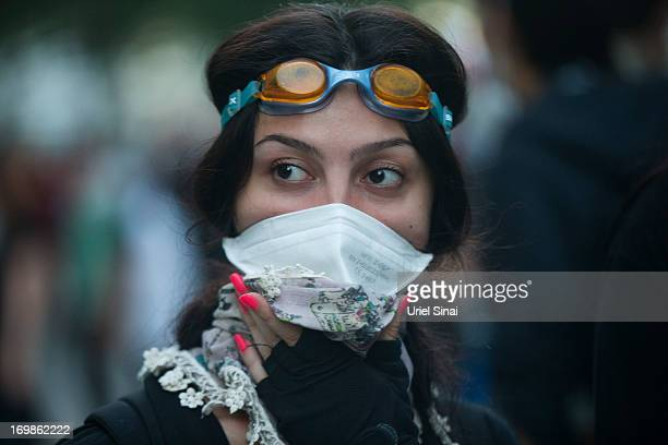 A protestor covers her face during clashes with Turkish police near Turkish prime minister Recep Tayyip Erdogan office between Taksim and Besiktas on...