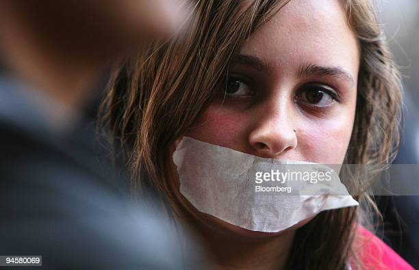 A protestor demonstrates with tape over her mouth in the central business district during day seven of the AsiaPacific Economic Cooperation meeting...