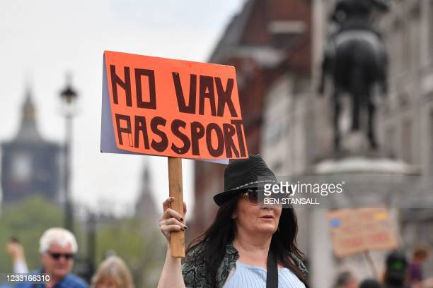 Protestor displays an anti-vax placard during a 'Unite For Freedom' march against Covid-19 vaccinations and government lockdown restrictions, in...