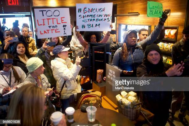 Protestor Donn T demonstrates inside a Center City Starbucks on April 15 2018 in Philadelphia Pennsylvania Police arrested two black men who were...